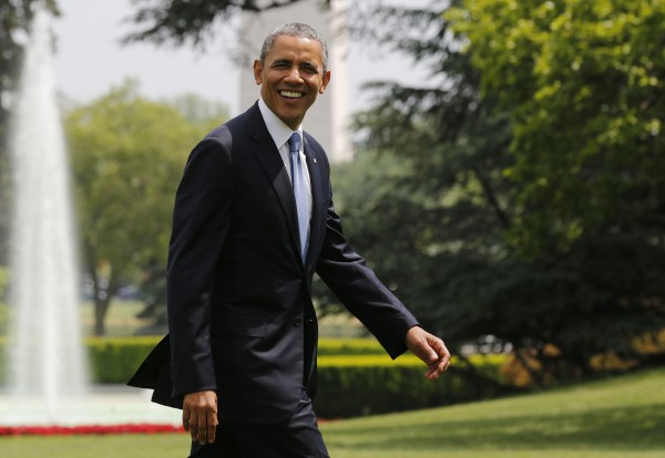 U.S. President Obama smiles as he walks away from Marine One on the South Lawn at the White House in Washington