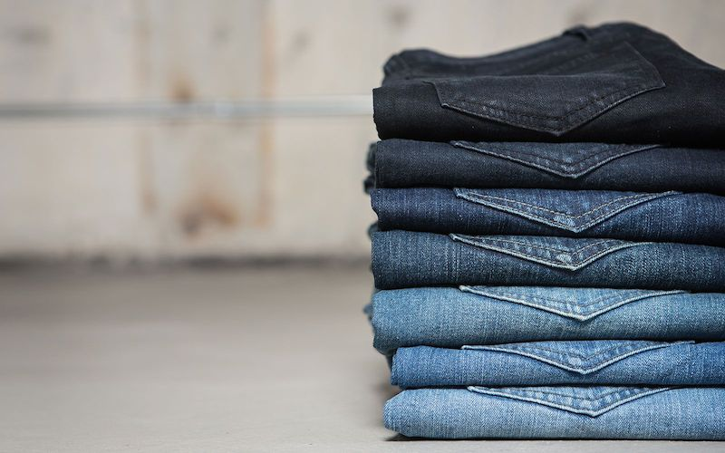 washed-jeans-stack-ba914286bd29f71f44a879705faefd3e