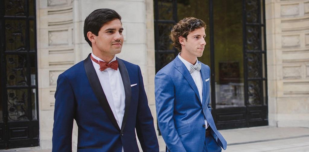 deux hommes portnt un costume sur mesure